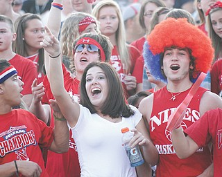 Niles fans cheer on the Red Dragons during their game against the Girard
