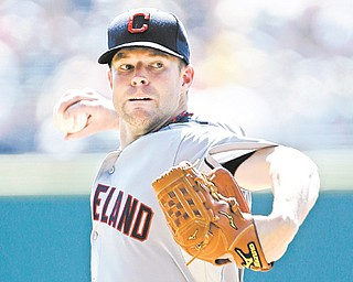 Cleveland Indians starting pitcher Corey Kluber delivers a pitch against the Detroit Tigers in the first inning of a game in Detroit on Monday. Kluber got his first career victory in the Indians' 3-2 win.