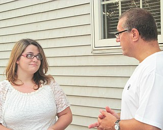 At the annual summer picnic for the Penn State University Alumni Chapter of Greater Youngstown, Emily Lewis, left, was presented with the 2012 Allen Udell Memorial Scholarship of $1,000. She is shown talking with Chapter President Gerry Ricciutti. Lewis was chosen based on grades, academic achievement and college test scores. She will be attending the Shenango campus in Sharon and plans to study nursing. The chapter has awarded more than $18,000 to Penn State freshmen in the past 15 years.