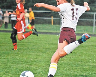 Nicole Deley of Boardman moves the ball upfi eld during Wednesday's game against Cardinal Mooney. The Cardinals won, 3-2.