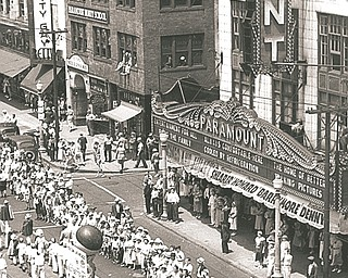VINDICATOR FILE PHOTO...A parade of Vindicator carriers passes by the Paramount Theater, downtown Youngstown, in 1937. At left of the theater is McKelvey's Department Store, one of two anchor stores on West Federal Street, along with Strouss-Hirschberg's.