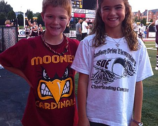 They may go to the same elementary school, but Guy Young and Mia Hammerton were cheering for opposite sides at the Boardman vs Mooney game!