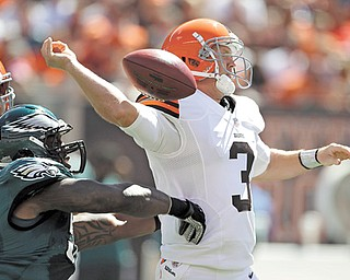 Cleveland Browns quarterback Brandon Weeden (3) has the ball knocked from his hand by Philadelphia Eagles defensive end Trent Cole in the first quarter of a game in Cleveland on Sunday. Weeden had one of the worst debuts in NFL history, a 5.1 rating. Cleveland's defense forced five turnovers but couldn't get the one it needed to stop Michael Vick. It added up to another tough loss, but one that showed some promise for a young team.