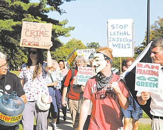 Protesters at an anti-fracking rally march from the The First Unitarian Universalist Church of Youngstown to the Stambaugh Auditorium. Alice Lynd, top, participated in the rally Wednesday.