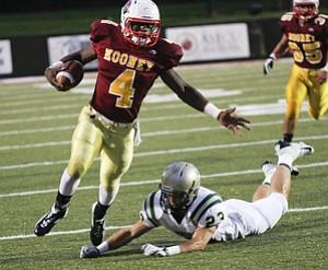 ROBERT  K.  YOSAY  | THE VINDICATOR --..CM  #4   Marcus McWilson  as he breaks away from svsm #23    Nathan Bischof - as he heads for a first down  #35  CM Anthony Dermotta  Akron St Vincent St Mary @ Cardinal Mooney  at YSU Stadium..(AP Photo/The Vindicator, Robert K. Yosay)