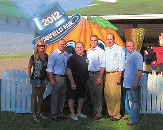 Austintown officials recently treated Penn National Gaming representatives to a day at the Canfield Fair. This photo, at the pumpkin display, includes from left, Austintown Trustee Lisa Oles, Rick Leonard from Congressman Tim Ryan's office, Austintown Trustee David Ditzler, Penn National Gaming Vice President Eric Shippers, Penn National Gaming President Tim Wilmott and Austintown Trustee Jim Davis. Missing is State Representative Ron Gerberry, who also welcomed the visitors.