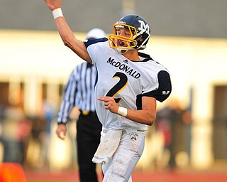 Mcdonald quarterback #2 Christian Rusinowski throws a pass early int he first quarter during Friday nights game against Western Reserve.