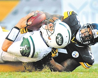 Pittsburgh Steelers outside linebacker LaMarr Woodley sacks New York Jets quarterback Mark Sanchez in the third quarter of Sunday's NFL game in Pittsburgh. The Steelers flattened the Jets, 27-10, behind quarterback