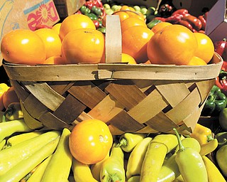 A tisket a tasket — yellow tomatoes and hot peppers in the basket at Huff man Fruit Farm in Greenford.