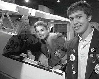Preparing to take flight are Rotary Club of Youngstown's inbound and outbound exchange students, who are examining the airplane exhibit at the OH WOW Children's Museum in downtown Youngstown. On the left is Gauthier Gaillard, 16, a student who arrived in the United States on Aug. 28 from Les Herbiers, France. He is attending Ursuline High Schooland plans to study architecture after he graduates. At right is Alex Chiu, an exchange student to Stuttgart, Germany from Rotary District 1830. He graduated this year from Canfield High School and plans to pursue studies in language and international business. He also is a third-generation Rotarian. His father, Kevin Chiu, and grandfather, Dr. Y.T. Chiu, are members of Rotary Club of Youngstown.