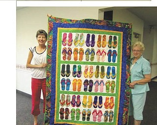 Kelly DePalma, left, and Cynthia Briggs, members of IQ Quilt Club, show off a novelty quilt featuring a design with flip-flops that will be a door prize at the 33rd annual quilt show planned from 9 a.m. to 5 p.m. Sept. 29 at New Vernon Grange, 239 Sheakleyville Road, Clarks Mills, Pa. Donation is $2. The event will include quilting demonstrations and fabric dying, a country store with quilt-related items and four fabric and sewing machine vendors. DePalma's fabric quilt creations will be showcased. Grange members will serve lunch. Quilts may be entered in the show by taking them to the grange by 2 p.m. Friday Sept. 28. For information call 724-376-2124 or 814-425-3375.