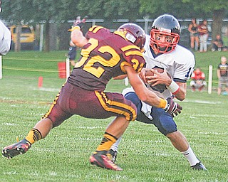 Warren JFK's Dominic Naples (10) outmaneuvers Robert Seman (32) of South Range during their 2012 season opener at South Range High School. With a 4-0 record, the Eagles are off to their best start since 2006.