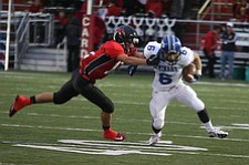 NICK MAYS l THE VINDICATOR  (6) Anthony Marchionda of Poland can't get away from (12) Drew Rogers during the first quarter of thier game in Canfield Friday night. poland vs canfield 09212012 canfield, ohio