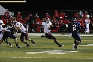 ROBERT  K.  YOSAY  | THE VINDICATOR --.. #1 Bdm Nathan Jones mmakes a cut on #2 Fitch KerrellJohnson  on his way for the only touchdown - Boardman  vs Fitch @ Fitch   ..(AP Photo/The Vindicator, Robert K. Yosay)