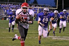 IMG 3398: Temeko Holness (10) of Struthers runs up the sideline after catching a pass during the second quarter of Friday nights matchup at Hubbard High School. ÊDustin Livesay Ê| ÊThe Vindicator Ê9/21/12 ÊHubbard, Ohio