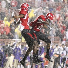 Willim D. Lewis the Vindicator   YSU's Andrew Williams(80), left, and Marcel Carver(16) react after Williams scored  the second YSU TD of the game during 1rst qtr agaisnt UNI Saturday.
