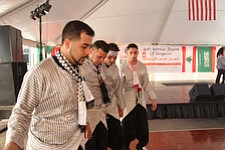 Four members of the Arab Community Center in Liberty perform a traditional Dabke dance at the Arab-American Festival of Youngstown on Saturday. From left are: Mureed Amireh, Ike Omran, Mohammed Salman and Samir Esmail.