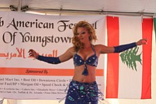 "Kelli Krzynowek, also known as ""Kelli Belly,"" a member of the Wind and Sand Dance Company from Cleveland, performs a belly dance during the first Arab-American Festival of Youngstown on Saturday."