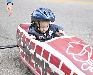 Garrett Teutsch, 2, of Girard rides in a soap-box derby car during the second annual Silly Science Sunday at the OH WOW! The Roger & Gloria Jones Children's Center for Science & Technology in Youngstown. The event featured a variety of science-related activities.