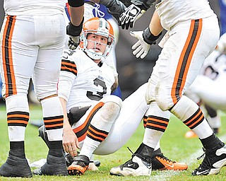 Cleveland Browns quarterback Brandon Weeden (3) is helped up after being knocked down by the Buffalo Bills defense in the fourth quarter of Sunday's NFL game in Cleveland. The Browns were plagued by penalties, dropped passes, an inability to stop the run and turnovers, including two interceptions in the final four minutes as Weeden was trying to rally his team. The Browns fell 24-14.