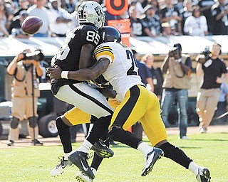Oakland Raiders wide receiver Darrius Heyward-Bey is hit in the end zone by Pittsburgh Steelers free safety