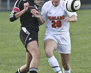 William D.Lewis The Vindicator  Canfield's Kaylee Buchenic(16) and Howland's Morgan Scott (28) gofor the ball during Monday action at Howland.
