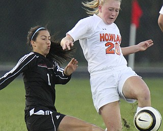 William D.Lewis The Vindicator  Canfield's Lauren Pettola (11) and Howland's Morgan Scott (28) go for the ball during Monday action at Howland.