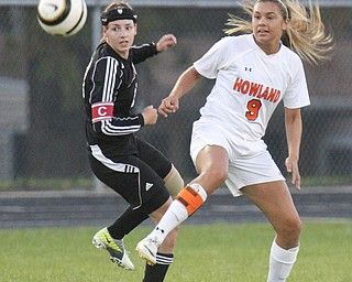 William D.Lewis The Vindicator  Canfield's Jen Morris(23) and) and Howland's Seyla Perez(9) go for the ball during Monday action at Howland.