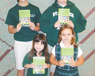 Students of St. Patrick School in Hubbard are selling entertainment books for $30. In front are Rachel Lucarelli, left, and Nora Depizzo, and in back are Sofie Madeline, left, and Daniel Robinson. The books offer discount coupons to restaurants, sporting events, activities and more. Stop by the school office at 38 E. Water St. to purchase, or call the school at 330-534-2509 for information. All proceeds fund the activities of the school.