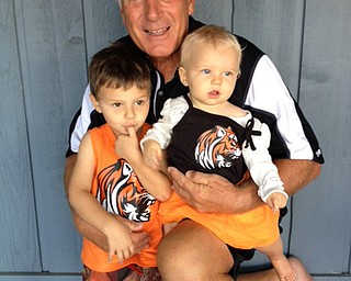 Howland coach dick angle and his two best fans  grandchildren Jake and Payton Angle