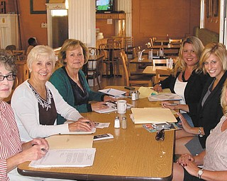 Trumbull County Medical Society is planning a fundraiser for Access Health Mahoning Valley. Involved in the project are, from left to right, Marjorie Dangaron and Carol Olsen, TCMS volunteers; Cheryl D'Amore, AHMV board member; Alyson Scott Spon, executive director of TCMS; Amanda Mesmer, executive director of AHMV; and Molly Halliday, fundraising volunteer.