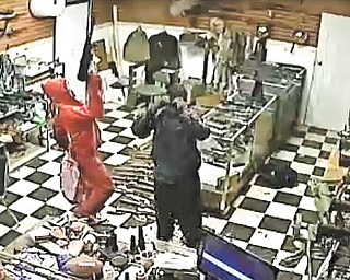 Video surveillance shows the breaking and entering at AAA Customs where dozens of high-powered weapons were taken. Police believe three people were involved in the theft and are hoping they can be identified from this still photo.