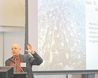 Trent Dougherty, chief legal analyst for the Ohio Environmental Council, stands before a group of journalists Thursday to explain the complexities of the oil and gas industry.