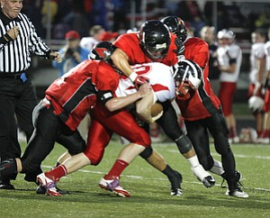 ROBERT  K.  YOSAY  | THE VINDICATOR --..No where to go as Niles #40  Stefan Yuhas  is corraled by  Canfields  84 Kyle Nagy  11  Jake Dawson and  32  Nick Annichenni --  at the line during second quarter action ---Niles at Canfield - Bob Dove Field ..(AP Photo/The Vindicator, Robert K. Yosay)
