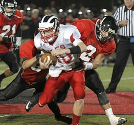 ROBERT  K.  YOSAY  | THE VINDICATOR --..Brought down after a first down during second quarter action -  is Niles #40  StefanYuhas - by Canfields #84  Kyle Nagy and #2 Nick Annichenni - after he got the first down ..Niles at Canfield - Bob Dove Field ..(AP Photo/The Vindicator, Robert K. Yosay)