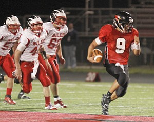 ROBERT  K.  YOSAY  | THE VINDICATOR --..Canfields #9  Kim Kimu  takes off for a 30 plus yard run and a first down during third quarter action as  #40  Stefan Yuhas  #60  Nick Lardas -  #5  Nick Sanchez give chase --.Niles at Canfield - Bob Dove Field ..(AP Photo/The Vindicator, Robert K. Yosay)