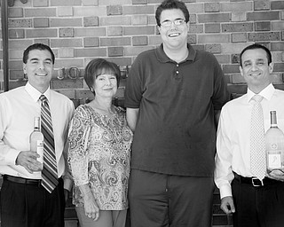 From left to right are Dan Memo, Geri Kosar, Brian Forward and John Beato, committee members for the Napa Valley to the Mahoning Valley fundraiser to benefit the Rich Center for Autism. The fundraiser will take place Nov. 9 at Our Lady of Mount Carmel Church Hall. PHOTO BY: MADELYN P. HASTINGS | THE VINDICATOR