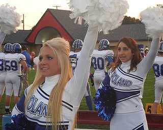 Seniors Kelsey Gill and Alyssa Carline cheer on their Poland Bulldogs during the Poland/Struthers game
