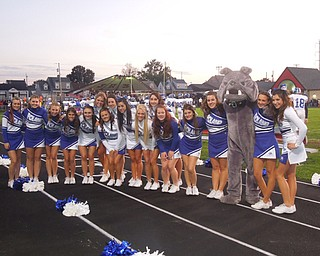 Poland Varsity and Junior Varsity cheerleaders are all smiles after the Bulldogs big win against Struthers