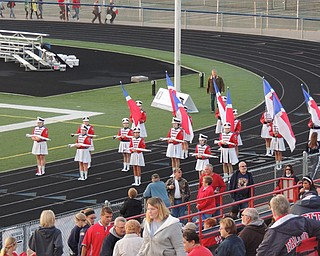 Rifle and flag lines at attention while the homecoming king and queen are announced