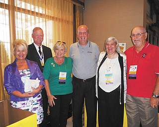 """Kiwanis Ohio District members took school supplies to their recent convention in Boardman to participate in the United Way of Mahoning Valley's """"Stuff the Bus"""" campaign. Among those involved with the project were Phyllis Ricadonna of Steubenville, left, Lt. Governor for Division 21; Randy Beard of Warren, immediate past president of the Ohio District Kiwanis Foundation; Katie Rennard of Akron, district convention service chair; Bob Hannon, executive director of United Way of the Mahoning Valley; Barbara Smith of Girard, Ohio district convention chair; and Tom Eisenbraun of Youngstown Kiwanis Club and past governor of Division 21."""