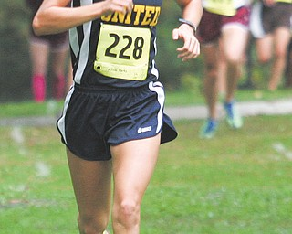 Allison Parks of United leads the pack in the ITCL girls cross country race Tuesday in McDonald. Parks eventually won the race.