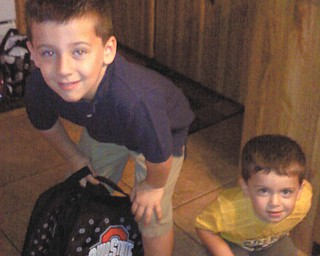 Judy Wilson of Struthers sent this picture of the two loves of her life, grandsons Vincent Boila, 5, who is heading to his first day of kindergraten at Lowellville Schools, and Patrick Boila, 2, on his way to the first day of day care.
