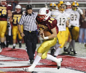 ROBERT K. YOSAY  | THE VINDICATOR..Mooneys Jon Saadey runs into the endzone untouched as Mooney made its first score in the second quarter .Lakewood St Edwards vs Cardinal Mooney at Stambaugh Stadium at YSU -... - -30-..