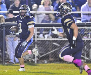 Brookfield running back #3 Ryan Mosora runs the ball down the sideline after making it into the open field on the running play.option play.