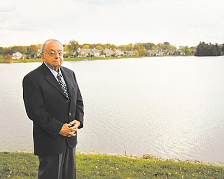 Philanthropist Dr. Dominic Bitonte stands in front of the lake in the backyard of his home in Columbiana.