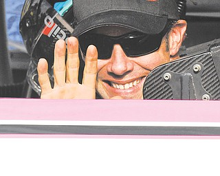 Matt Kenseth waves from his car in Victory Lane after winning Sunday's NASCAR Sprint Cup race at Talladega Superspeedway in Talladega, Ala.