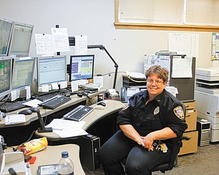 Kim Stolic of Hubbard has worked as Hubbard city 911 dispatcher for 20 years. She will be the last dispatcher on duty when the city's emergency-call services are transferred to the Trumbull County 911 Center on Thursday morning.