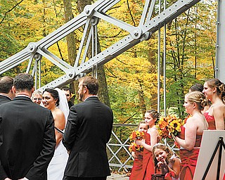Julie Posey and Joshua Shaull, both of Cortland, were married Sunday on the silver Suspension Bridge in Mill Creek MetroParks. The couple chose the date and location so the natural scenery of autumn could serve as decoration.