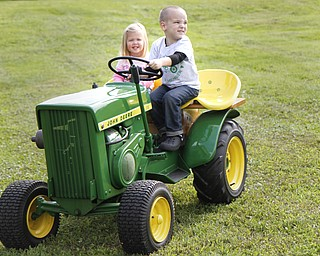 MADELYN P. HASTINGS | THE VINDICATOR  Audrey Booth, 2, and Kaden Phillis, 3, both of New Waterford rode a miniature tractor at the autumn festival.
